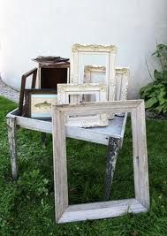 Collect vintage frames from antique shops, paint them all white and use them to frame table number signs.