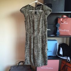 Maje 100% Silk Dress Size 1/XS/S Designer Leopard By Maje, one of my favorite French designers. Gorgeous! Has pockets and shoulder detailing. Unlined but I've never had issues because of the print. Zips up back. One side of the Maje tag inside came off so I just safety pinned it for now. I'm an XS and this fits with a little room in the midsection. Not a tight fit, but it's flattering due to the cut. Maje Dresses