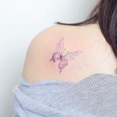 No photo description available. Watercolor Butterfly Tattoo, Butterfly Tattoo Designs, Butterfly Tattoo On Shoulder, Korean Tattoos, I Tattoo, Tatting, Boho Fashion, Body Art, Piercings