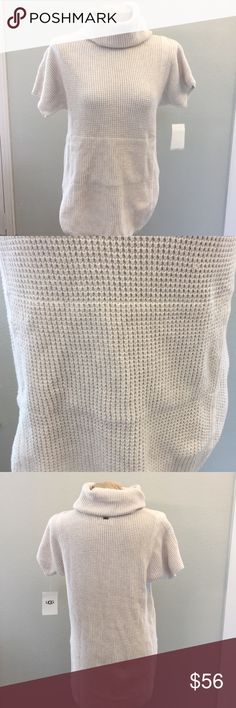 """UGG SWEATER NWT SHELBY CREAM SWEATER COLOR CREAM SIZE MEDIUM. Measures approximately Back length 29"""", Front Leather 26"""", Underarm to Underarm 18"""". Sweater is long in the back than front. Front of sweater also features Slit Pockets UGG Sweaters Cowl & Turtlenecks"""