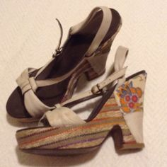 Boho Chic Flowers & Stripes Wedge sandals  Wedge heels are covered in colorful stripe and floral woven fabric. Cream colored leather straps have some wear by discoloration (see pics), buckle at ankle and smooth leather insole in great condition. Really unique find at a Soho boutique in NYC years ago. Superb quality (made in Italy), worn a handful of times but they are too big for me, still a lot of life left!  Will fit 7.5 too.   Offers welcome! Free  with all purchases! Bundle discount❕…