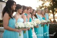 Dresses in shades of teal, gives this wedding a Breakfast at Tiffany's luxurious environment right outside of English Turn Golf and Country Club's clubhouse. No New York here though! Only a southern New Orleans wedding with a beautiful sunset, Oak trees with Spanish Moss, lush green lawns, and so much more that this beautiful venue has to show for.