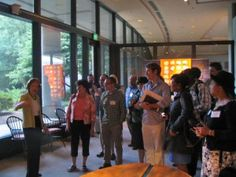 """This past July, twenty social studies teachers...participated in professional development training as attendees of The Camp David Accords 35 Years Later: Looking Back to Discover Future Prospects for Mideast Peace, the Jimmy Carter Presidential Library and Museum's 2013 Summer Seminar for educators."" In this image, Rosalynn Carter speaks to the group as they tour the museum."