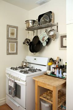 Smart kitchen storage. A rollaway island and shelf for pots and pans. Yet more proof that you don't need a big space to make it work.