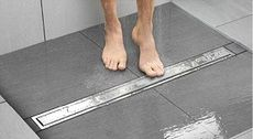 Linear Drain for the shower.  Allows larger format tiles to be used. Schluter-KERDI-LINE - Schluter-Systems