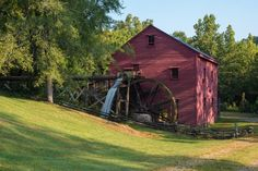 This unique CREEKSIDE property comes with a completely restored water wheel-powered, belt-driven grist mill that dates back to approx. 1800 and is fully operational. Hearthstone log cabin construct…