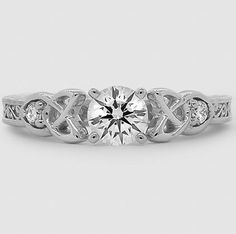 The intricate detail of this stunning diamond engagement ring is so unique.