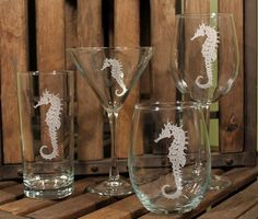 Seahorse Etched Glassware - so pretty!  I am ordering the stemless wine tumblers for myself.