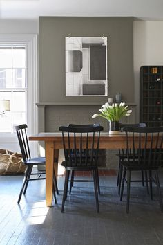 Fireplace paint: Benjamin Moore Gunsmith Gray. In 1984, designers Jeffrey and Cheryl Katz purchased a four-story townhouse in Boston's historic Beacon Hill. A corner tenement with a winding stair, the b