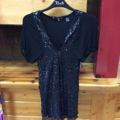 Sexy sequin shirt Truly a brilliant piece to wear with any of my Miss Me Jeans. She is covered in sequins and fully lined. Definately small more like Xs. 11 in from under arm to under arm. 26 in long. Gentle wash polyester and rayon.new without tags. Miss Me Tops