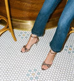 Things that go together: #shinyponies & good floor tiles. (Shop the leopard bow sandals via the link in our bio.)