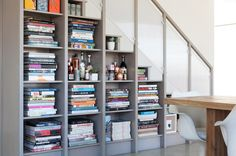 12 Inventive Ways to Build Storage Into Your Staircase // Consider these 12 ideas for building in cabinets, shelves and more to better utilize your stairway space