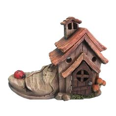 Hi-Line Gift Ltd. Add to the whimsy of your fairy garden with this stunning miniature shoe house complete with windows and wooden door. Young and old, everyone enjoys the magic of a fairy garden, and this fairy garden house is destined to impress. Clay Fairy House, Gnome House, Fairy Garden Houses, Fairy Gardens, Smurf House, Teacup Pug, Old Nursery Rhymes, Clay Fairies, Ceramic Houses