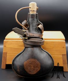 Leather flask l with carved symbol. Cowhide Leather, Leather Craft, Flask, Vikings, Medieval, Craft Supplies, Alcohol, Container, Table Lamp