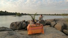 We often do island sundowners. When guests are out on the boats we sneak up to our favourite island and set up a mini bar in the middle of the river. Sneaks Up, Under The Stars, Camps, Fine Dining, Lodges, Boats, Safari, National Parks, Middle