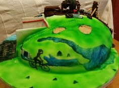 Multiple activities birthday cake for very active/adventurous lady, squash, cycling, mud challenge, golf and running marathons