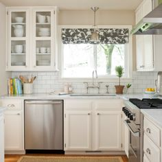 white cabinets and backsplash tiles
