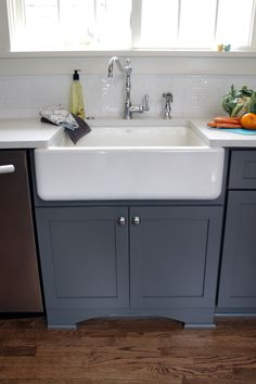 Painted gray Dura Supreme Cabinetry, Kohler farm house style sink