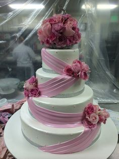 Fun quinceañera cake. With Light pink fondant draping decoration.