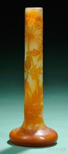 Galle Cameo Glass Vase  Art glass  France  Long neck on bulbous base, fire polished cameo decoration depicting flowers and leaves in burnt orange on shaded green orange ground, marked Galle in cameo.