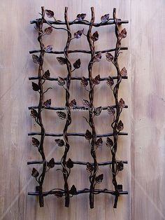 The leaf design trellis pieces are available in a circular or rectangular format making them ideal for settings where accessories need to be linked.   A leafed trellis can help restore the balance of nature in plain spaces. It's also a perfect trellis for flowering climbers that loose their leaves.