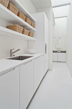 all-white laundry room