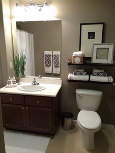 "Guest bath - paint color is ""Taupe Tone"" by Sherwin Williams."