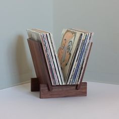 Solid walnut LP record stand in 4 parts. Leaves fit into notches in feet to create a solid stable platform for viewing and displaying albums. Displays