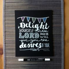 Handwritten chalkboard bible verse 'Delight yourself in the Lord and he will give you the desires of your heart' Psalm 37 v 4