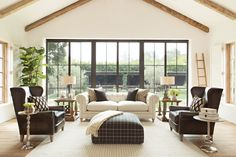 Vaulted ceilings and an abundance of light allows room to incorporate oversized wing back leather chairs and darker hues. See more inspiration rooms. #LivingSpaces