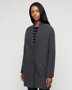Textured boucle coat with two-button closure in a wool-blend. Stand up collar, long sleeves, and full lining. Style with your casual or tailored wardrobe this season.