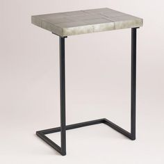 Fuselage Laptop Table, at WorldMarket.com. Cool industrial look would be great as a side table in a small space or to use as a multipurpose TV tray (and so much better looking than the classic folding ones!) $79