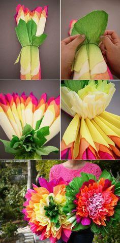 große, bunte papierblumen basteln aus krepppapier, frau mit rosa bluse
