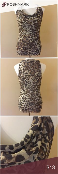 "Sweet Pea Animal Leopard Cheetah  Print Cowl Tank Sweet Pea Animal Leopard Cheetah  Print Cowl Tank --- size medium --- styles in sweet pea's traditional two layers of stretchy nylon --- 19"" bust --- 27.5"" length --- excellent preloved condition --- thank you for visiting my boutique and please feel free to ask any questions ❤️❤️ Sweet Pea Tops Tank Tops"