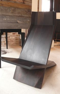 Caste Design's walnut chair- designed to be almost ergonomic perfection. All for the low-low price of approx 4,000