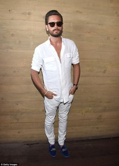 The Lord cometh: Scott Disick is clearly comfortable in head-to-ankle white, but he mixed it up for the party with his blue velvet slippers emblazoned with Lord Disick