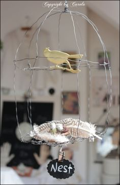Wire bird cage from: Boxwood Cottage: About painting black & white, repurposing & crafting