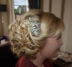 soft looped side updo with a vintage slide another of the gel Bridal Academy 's styles