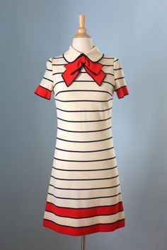 Vintage 1960s cream 100% wool knit dress with navy blue stripes with red trim. Peter pan collar and a fabulous bow
