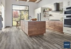 Vinyl wood plank flooring is an ideal flooring choice for your kitchen #vinylflooring #vinylplankflooring #kitchenflooring #contemporarystyle