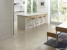 Very light cream-gray kitchen floor tiles