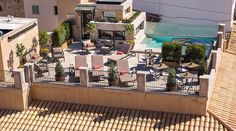 Centrally located in Palma de Mallorca, the Gloria de Sant Jaume is a centrally located hotel in the city, set in a palace. Gold Framed Mirror, Large Beds, Hotel Website, Hotel Palma, Balearic Islands, Spacious Living Room, Rooftop Terrace, Hotel S, Moorish