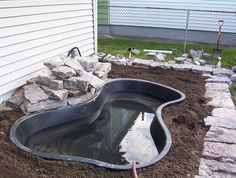 DIY Water Garden and Koi Pond  You can buy the kits at Lowes or Home Depot.