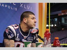 Aaron Hernandez takes questions at Lucas Oil Stadium