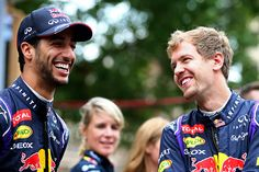 Daniel Ricciardo of Australia and Infiniti Red Bull Racing and Sebastian Vettel of Germany and Infiniti Red Bull Racing smile as they talk before driving along North Congress Avenue during previews ahead of the United States Formula One Grand Prix on the streets of Austin on October 29, 2014 in Austin, United States.