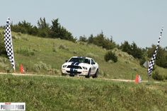 Ford Mustang crossing the finish line at the 2011 Sandhills Open Road Challenge    www.powerpacknation.com