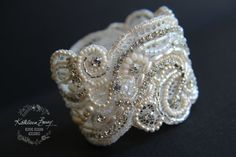 Hours and hours of work later I am finally happy with this Bridal Cuff bracelet, I have used re-purposed Vintage lace hand stitched rhinestones, Japanese glass seed beads, cubes, delica beads, Czech pressed glass flowers and assorted seed pearls, this bracelet is firm and holds
