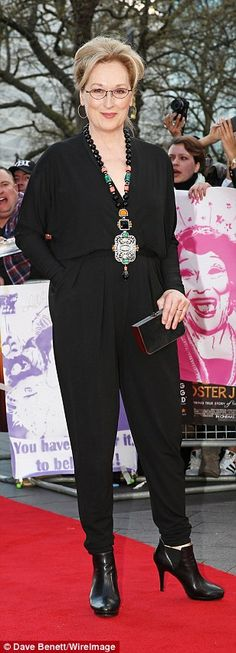 Working it! The 66-year-old screen icon looked sensational in a black jumpsuit, dressing u...