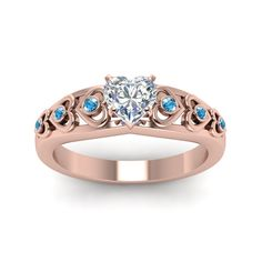 Heart Design Accent diamond Side Stone Engagement Rings with Ice Blue Topaz in 14K Rose Gold exclusively styled by Fascinating Diamonds