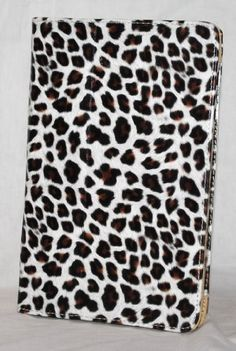 White with Brown Leopard Spots Design Amazon Kindle Fire Tablet Case with Built in Kick Stand Function by Design & Motion. $11.99. Sleek and portable. Our case offers protection with easy access to all ports. Its synthetic leather exterior make this the perfect solution to keep your Kindle secure and ready to use. Built-in kick stand, so you can easily enjoy hands-free video viewing on any flat surface, anywhere! Easy access to the side controls as well as the dock connector